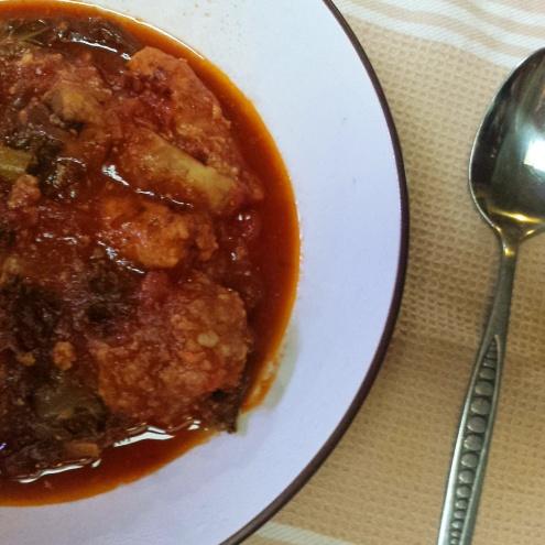 Meatball, chorizo and mushroom stew with sauteed kale